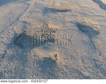 Potholes With Pits On The Old Asphalt. Damaged Road