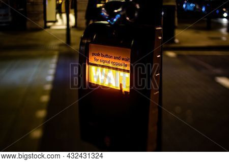 Street Crossing Device In Central London With Focus On The Push Button And Wait For Signal Opposite,