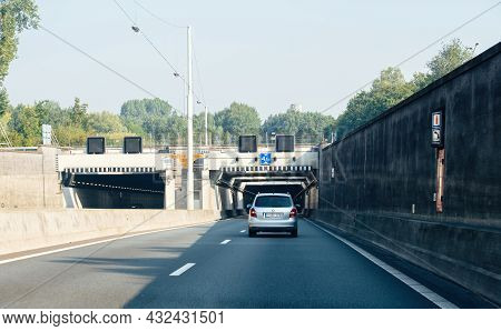The Netherlands - Aug 27, 2019: Rear View Of Skoda Fabia Car Entering Dutch Tunnel On The Highway