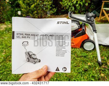 Paris, France- Jun 12, 2021: Pov Male Hand Holding Looking At The Stihl Rma 443 Pv Vc 448 Lawn Mower