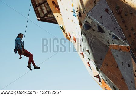 One Caucasian Man Professional Rock Climber Practicing At Training Center In Sunny Day, Outdoors. Co