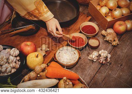 Top View Cooking Korean Pickled Kimchi, Korean Traditional Food, With Women Wearing Hanbok, Choosing