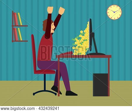 A Man Is Happy When A Big Pile Of Money Falls From The Monitor Screen. He Raised His Hands And Fists