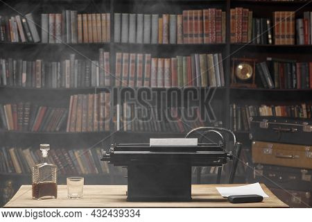 Close-up Of The Writer\\\'s Workplace, Desk. On The Table There Is A Bottle Of Alcohol And A Vintage
