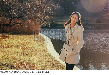 Happy Smiling Beautiful Young Woman Standing On Outdoor