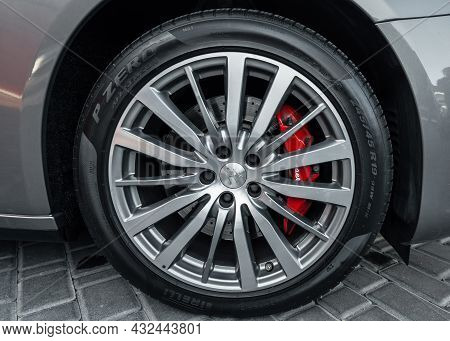 Ukraine, Odessa September 8 - 2021: Modern Automotive Wheel On Silver Alloy Disc. Maserati Rims With