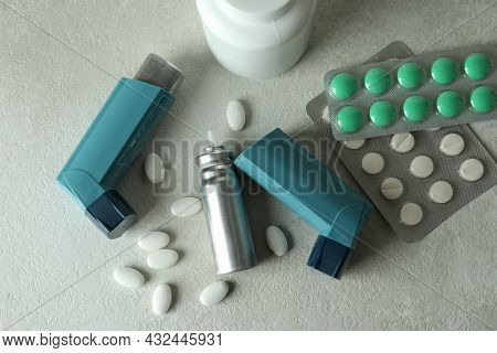 Asthma Treatment Accessories On White Textured Table
