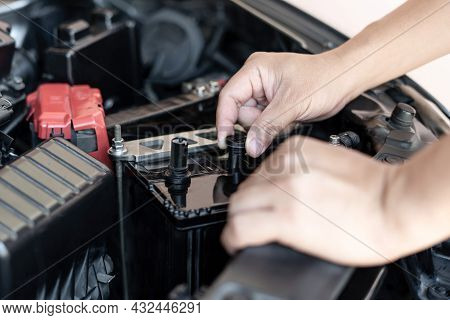A Man Open Cap Of Add Battery For Add Distilled : Maintenance And Inspections For Extended Service L