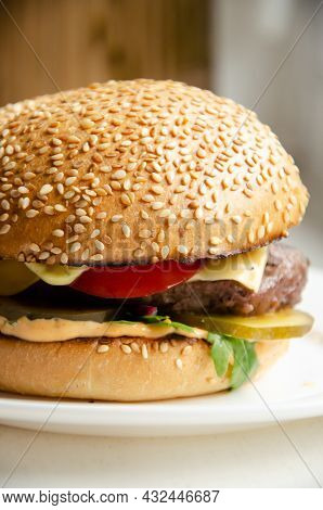 Juicy Burger With Baked Bun, Melted Cheese, Meat Patties And Vegetables. Unhealthy Food Concept. Del