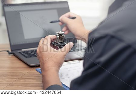 Hand A Man Hold Car Thermostat Of Engine Use Laptop Computer Check New Part In Stock Compare And Che