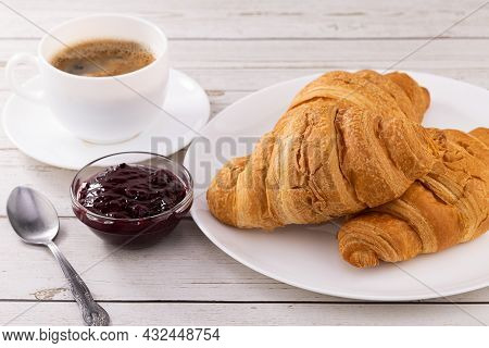 Cup Of Coffee And Croissants With Jam.