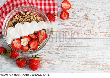 Bowl Of Oat Granola With Yogurt, Fresh Strawberry And Nuts On White Wooden Board For Healthy Breakfa