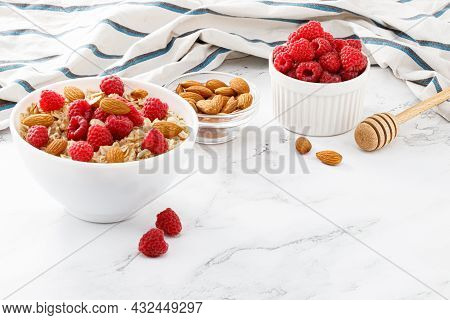 Healthy Breakfast. Bowl With Oatmeal With Fresh Raspberries And Almonds. Copy Space
