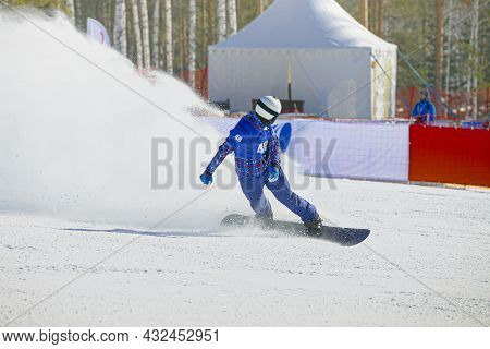 Snowboard Slow Down In Finish Line Behind It Splashes Of Snow