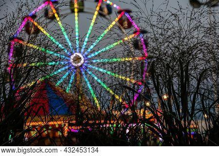 Amusement park ride after dark with lights