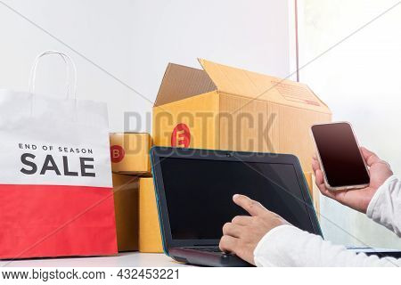 Asian Man Receiving Order,taking Order On Notebooks In Selling Products Online.concept Of Working At