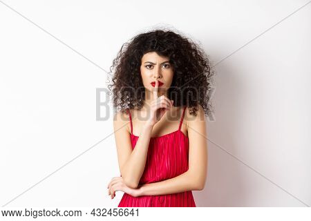 Angry Elegant Woman In Red Dress Hushing And Frowning, Tell To Be Quiet, Asking For Silence, Standin