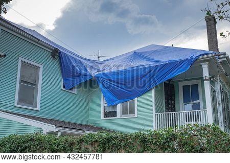 New Orleans, La - September 7: Blue Tarp On Roof Of Damaged Home From Hurricane Ida On September 7,