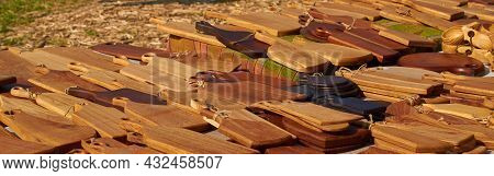 A Street Vendors Counter With Wooden Cutting Boards.