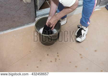 A Woman With Rag In Her Hands Washing A Floor, Indoor Shot