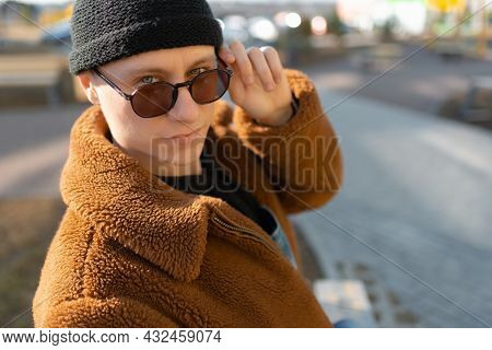A Man Is Gazing Inquiringly Over Sunglasses