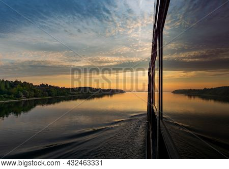 Sunset On The Volga River Reflected On The Large Windows Of A Modern River Cruise Ship