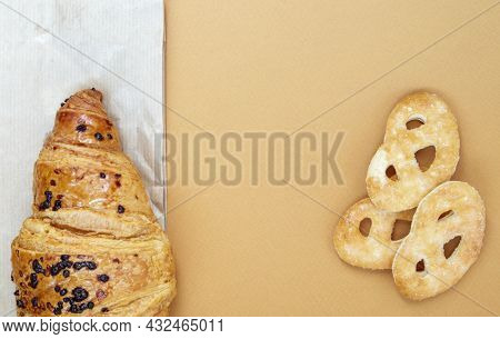 One Fresh Crispy Croissant With Chocolate Filling And Cookies On A Brown Or Coffee Background With C