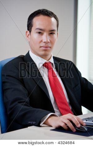 Asian Business Man Using Computer