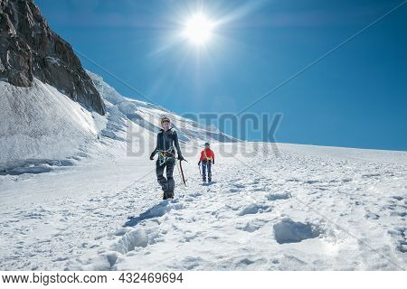 Two Laughing Young Women Rope Team Descending Mont Blanc Du Tacul Summit 4248m Dressed Mountaineerin