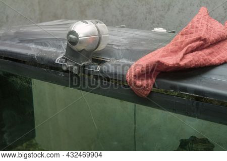 Auto Feeder And A Rag On A Top Of Old Dirty Fish Tank