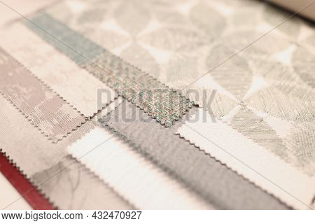 Closeup Of Samples Of Upholstery Fabrics In Store