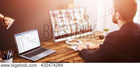 Virtual Telework Conference And Calendar Agenda On Desktop Monitor