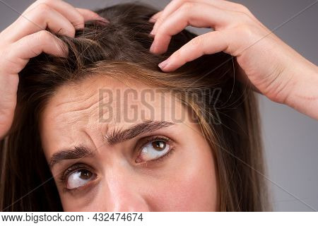 Stressed Woman Is Very Upset Because Of Hair Loss. Haircut And Straightening Hair Care. Serious Hair