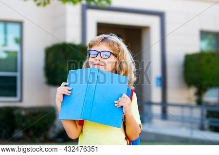 School Child Boy At School. Schoolboy Going Back To School. Kids Education Concept.