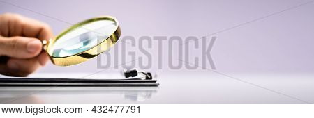 Lawyer Examining With Magnifier Glass. Business Tax Fraud Investigation