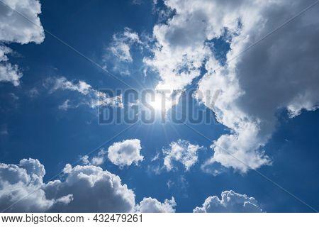 Shining Sun On Clear Blue Sky With Lens Flare Of Sunlight On Sky Background Bright Sun On Blue Sky C