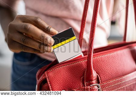 Woman Stealing Cigarettes In Retail Store. Shoplifting Theft Crime