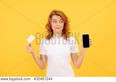 Amazed Woman Showing Credit Or Debit Card And Smartphone To Make Online Shopping, Online Business.