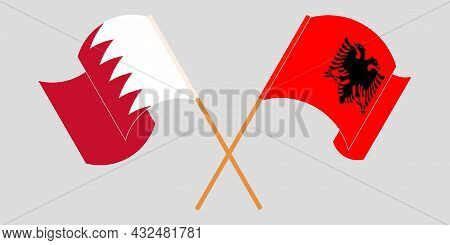 Crossed And Waving Flags Of Albania And Bahrain