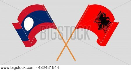 Crossed And Waving Flags Of Albania And Laos