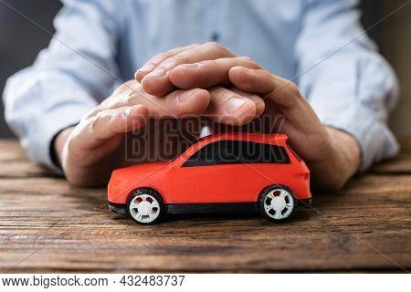 Car Insurance Guarantee. Safe Vehicle Concept. Secure Toy Auto