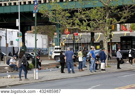 Bronx, New York, Usa - May 18, 2020: People Wait For Bus At Stop While Wearing Protective Masks Agai