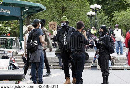 Bronx, New York, Usa - June 2, 2020: Two Black Lives Matter Activists Dressed In Black Tell Two Chri
