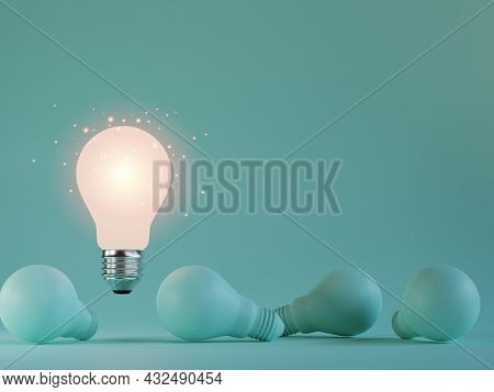One Of Lightbulb Glowing Among Shutdown Light Bulb  In Dark Area With Copy Space For Creative Thinki
