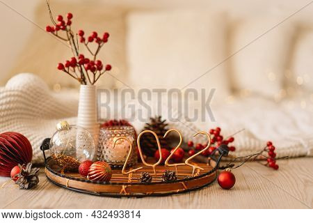 Happy New Years 2022. Christmas Background With Fir Tree, Cones And Christmas Decorations. Christmas
