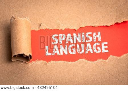 Spanish Language. Torn Cardboard On A Red Background