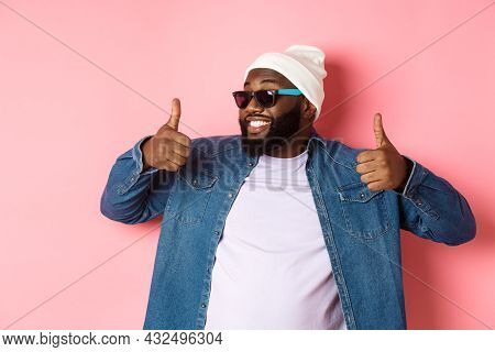 Happy And Satisfied African-american Guy In Sunglasses Showing Thumbs-up, Praise And Like Promo, Agr