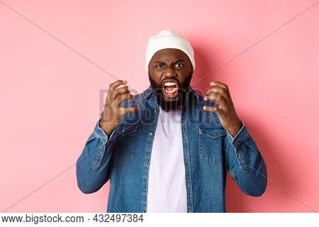 Angry African-american Guy Shouting And Looking Pissed-off, Scream At Camera, Standing Over Pink Bac