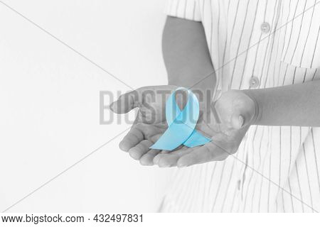 Hand Holding Light Blue Color Ribbon On White Isolated Background With Copy Space. Lymphedema And Pr