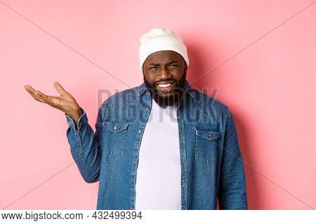 Annoyed And Pissed-off African-american Man Pointing Finger At Head, Scolding Someone Stupid, Starin